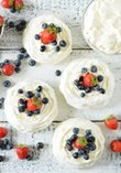 Meringue nests with whipped cream and fruit