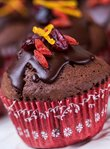 Chocolate muffins with goji berries, cranberries and fresh orange zest with dark chocolate coating