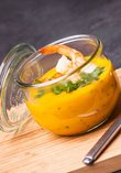 Pumpkin soup with coconut milk, ginger, fresh coriander and a prawn